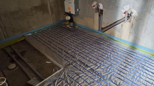 Elektrické podlahové topení.